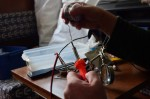 Steve continues to get good at soldering wire together